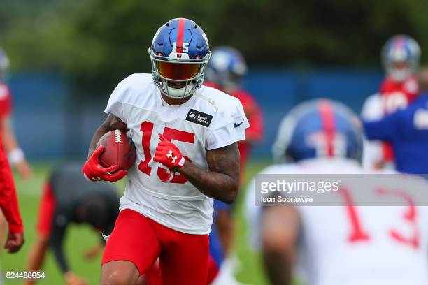 New York Giants wide receiver Brandon Marshall runs at teammate New York Giants wide receiver Odell Beckham during 2017 New York Giants training camp...