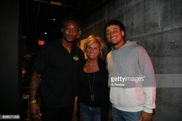New York Giants Wide Receiver Brandon Marshall Tight End Evan Engram and guest attend Project 375's 'Paddle Battle' pingpong charity tournament at...