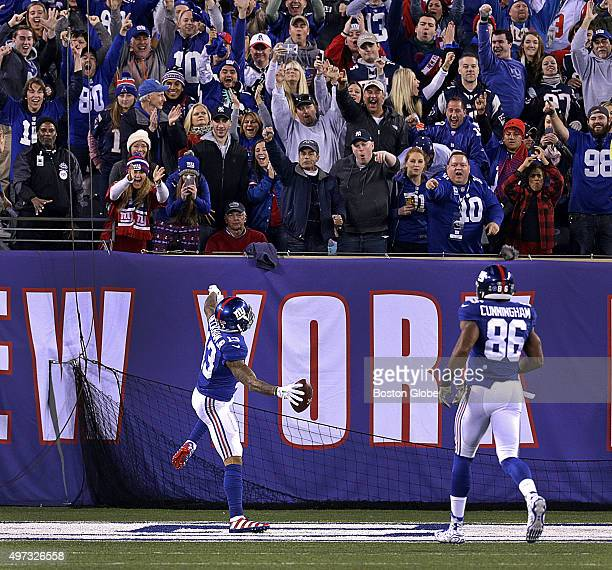 New York Giants wide receiver Odell Beckham took it to the house on a 87 yard touchdown reception as he celebrates with the fans in the end zone in...