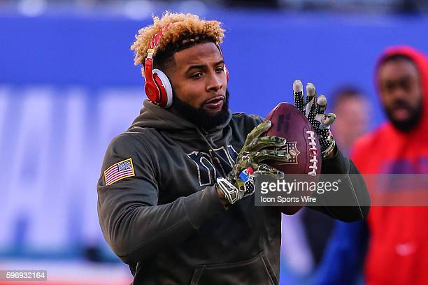 New York Giants wide receiver Odell Beckham with a French Flag on his glove warms up prior to the game between the New York Giants and the New...