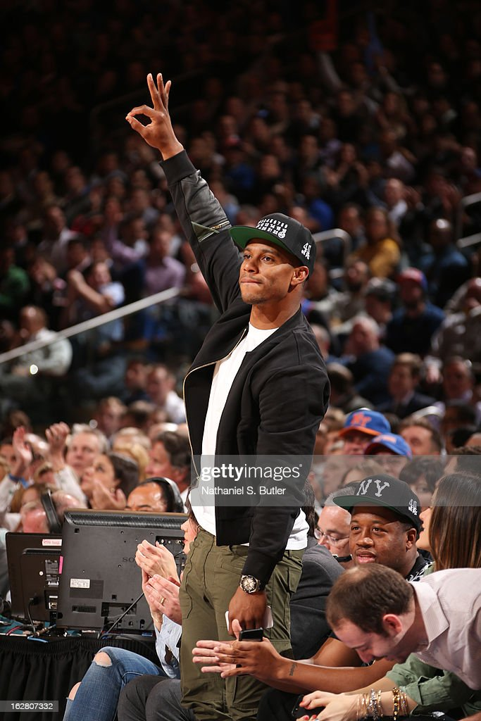New York Giants wide receiver Victor Cruz celebrates after the New York Knicks made a three-pointer during a game against the Golden State Warriors on February 27, 2013 at Madison Square Garden in New York City.