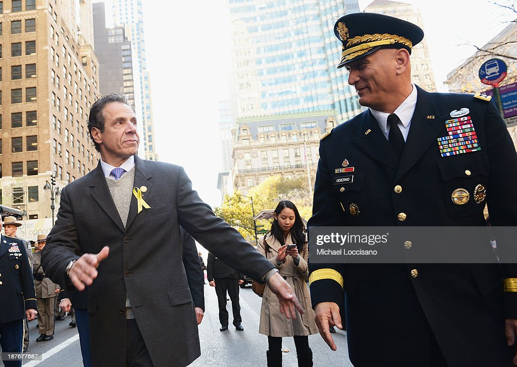 New York Gov. <a gi-track='captionPersonalityLinkClicked' href=/galleries/search?phrase=Andrew+Cuomo&family=editorial&specificpeople=228332 ng-click='$event.stopPropagation()'>Andrew Cuomo</a> (L) and Chief of Staff of the U.S. Army. General Raymond T. Odierno take part in the 94th annual New York City Veterans Day Parade on 5th Avenue on November 11, 2013 in New York City. The parade is the largest of its kind in the country and this year is especially dedicated to women serving in the armed forces.