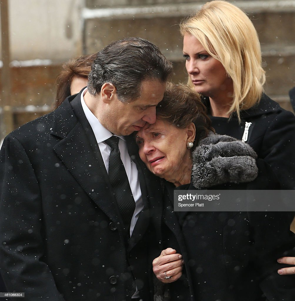 New York Gov Andrew Cuomo and his mother Matilda Cuomo watch as the casket of former threeterm governor Mario Cuomo departs St Ignatius Loyola Church...