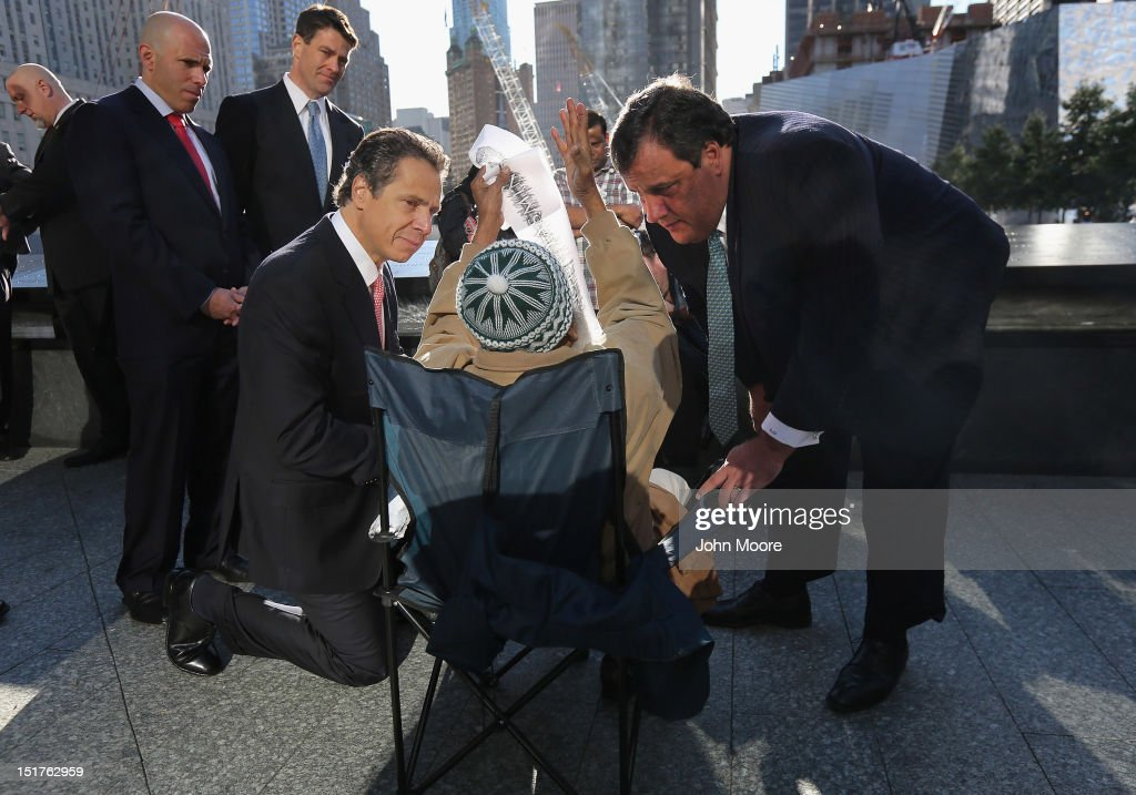 New York Gov. <a gi-track='captionPersonalityLinkClicked' href=/galleries/search?phrase=Andrew+Cuomo&family=editorial&specificpeople=228332 ng-click='$event.stopPropagation()'>Andrew Cuomo</a> (3rd R) and New Jersey Gov. <a gi-track='captionPersonalityLinkClicked' href=/galleries/search?phrase=Chris+Christie&family=editorial&specificpeople=6480114 ng-click='$event.stopPropagation()'>Chris Christie</a> (R), speak with Miah Afsaruddin (2nd R) during ceremonies for the eleventh anniversary of the terrorist attacks on lower Manhattan at the World Trade Center on September 11, 2012 in New York City. New York City and the nation are commemorating the eleventh anniversary of the September 11, 2001 attacks which resulted in the deaths of nearly 3,000 people after two hijacked planes crashed into the World Trade Center, one into the Pentagon in Arlington, Virginia and one crash landed in Shanksville, Pennsylvania.