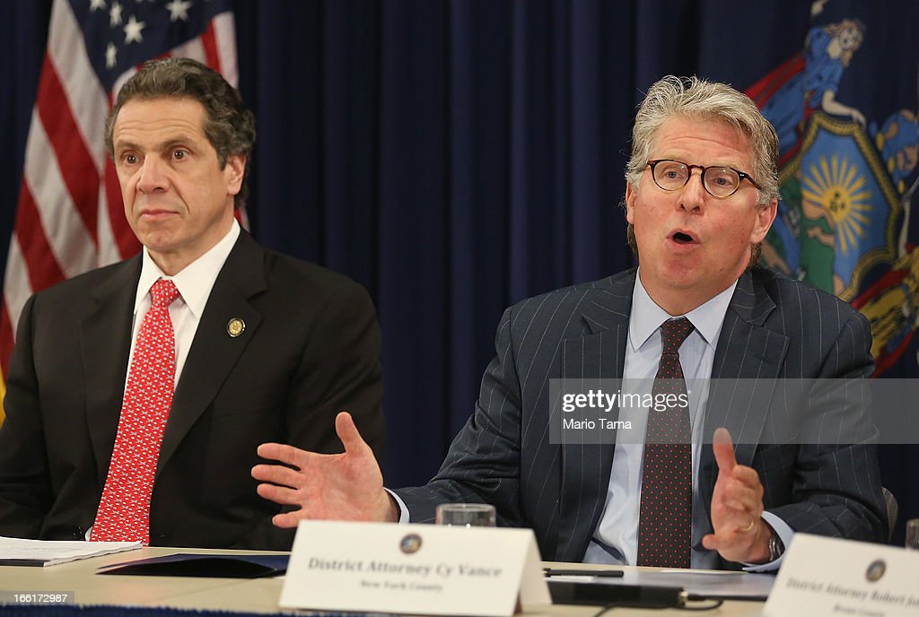 New York Gov. Andrew Cuomo (L) looks on as Manhattan District Attorney Cy Vance speaks at a press conference on new corruption legislation on April 9, 2013 in New York City. Cuomo announced the Public Trust Act which would establish a new class of corruption crimes and require officials to report corruption. New York State politicians were arrested in two bribery cases last week.