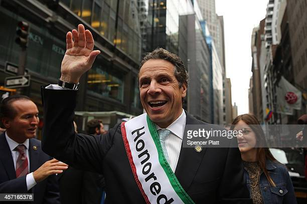 New York Gov Andrew Cuomo marches in the annual Columbus Day parade on October 13 2014 in New York City Organized by the Columbus Citizens Foundation...