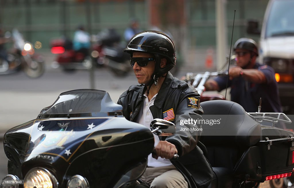 New York Gov. Andrew Cuomo (C), rides with members of the Fire Department of New York motorcycle club on September 11, 2013 in New York City. The nation is commemorating the anniversary of the 2001 attacks which resulted in the deaths of nearly 3,000 people after two hijacked planes crashed into the World Trade Center, one into the Pentagon in Arlington, Virginia and one crash landed in Shanksville, Pennsylvania. Following the attacks in New York, the former location of the Twin Towers has been turned into the National September 11 Memorial & Museum.