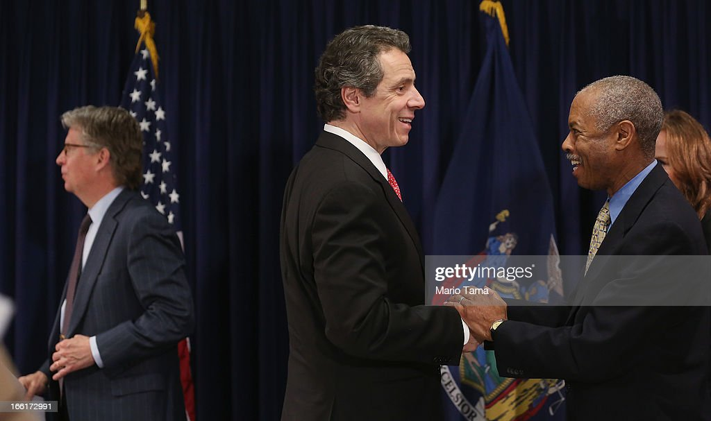 New York Gov. <a gi-track='captionPersonalityLinkClicked' href=/galleries/search?phrase=Andrew+Cuomo&family=editorial&specificpeople=228332 ng-click='$event.stopPropagation()'>Andrew Cuomo</a> (C) shakes hands with Bronx District Attorney Robert Johnson (R) as Manhattan District Attorney Cy Vance (L) looks on at the conclusion of a press conference on new corruption legislation on April 9, 2013 in New York City. Cuomo announced the Public Trust Act which would establish a new class of corruption crimes and require officials to report corruption. New York State politicians were arrested in two bribery cases last week.
