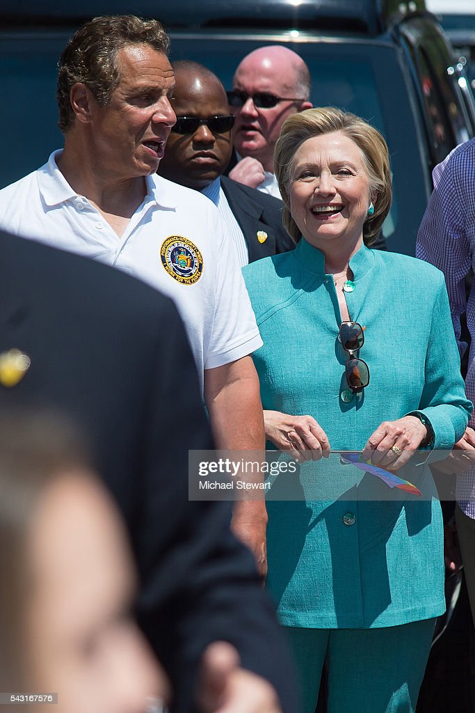 New York Governor <a gi-track='captionPersonalityLinkClicked' href=/galleries/search?phrase=Andrew+Cuomo&family=editorial&specificpeople=228332 ng-click='$event.stopPropagation()'>Andrew Cuomo</a> (L) and Democratic Presidential candidate HIllary Clinton attends the 2016 Pride March on June 26, 2016 in New York City.