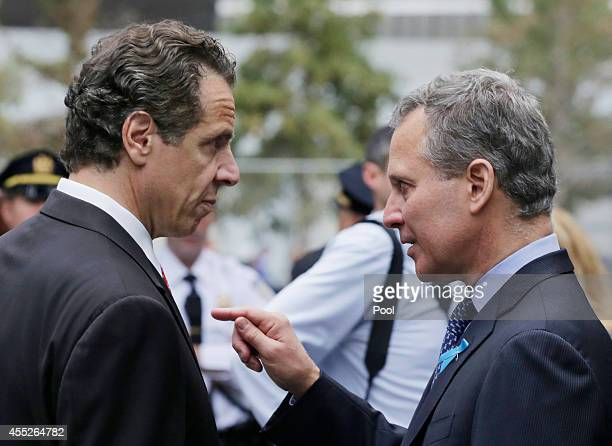 New York Governor Andrew Cuomo and New York Attorney General Eric Schneiderman talk during memorial observances held at the site of the World Trade...