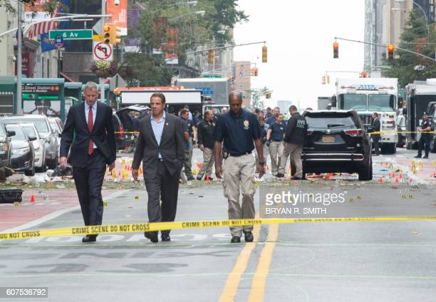 TOPSHOT New York Governor Andrew Cuomo and New York City Mayor Bill de Blasio arrive at the scene of an explosion on West 23rd Street September 2016...