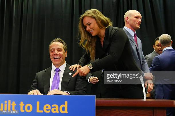 New York Governor Andrew Cuomo and UFC Fighter Ronda Rousey after signing a bill to legalize Mixed Martial Arts fighting in the state during a...