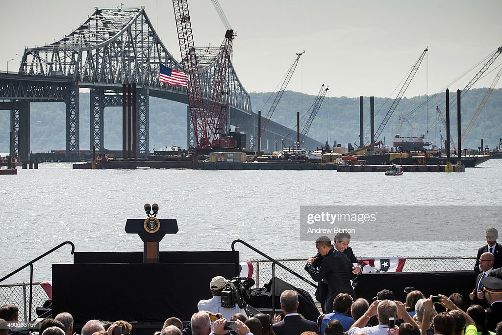New York Governor Andrew Cuomo and U.S. President Barack Obama embrace during a political event to talk about U.S. infrastructure at the Washington Irving Boat Club on May 14, 2014 in Tarrytown, New York. Tomorrow President Obama will attend the opening of the National September 11 Memorial and Museum.