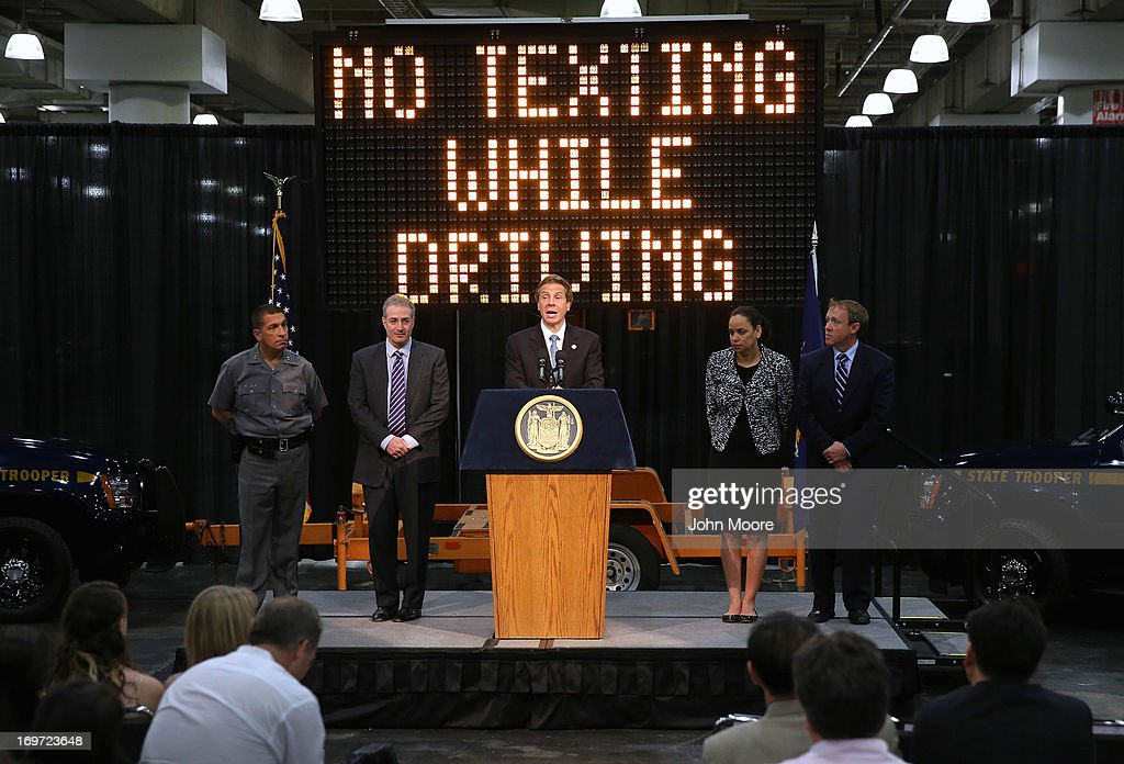 New York Governor <a gi-track='captionPersonalityLinkClicked' href=/galleries/search?phrase=Andrew+Cuomo&family=editorial&specificpeople=228332 ng-click='$event.stopPropagation()'>Andrew Cuomo</a> (C) announces a new bill with tougher penalties for texting while driving at a press conference at the Javits convention center on May 31, 2013 in New York City. The governor proposed additional penalties for young and new drivers ahead of the summer school break.