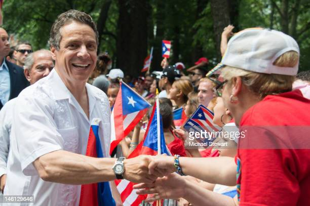 New York Governor Andrew Cuomo attends the National Puerto Rican Day Parade on the streets of Manhattan on June 10 2012 in New York City