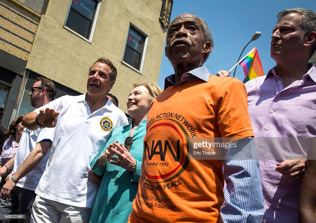 New York Governor Andrew Cuomo, former Secretary of State and Democratic Presidential candidate Hillary Clinton, Al Sharpton and New York mayor Bill de Blasio march during the New York City Pride March, June 26, 2016 in New York City. This year was the 46th Pride march in New York City