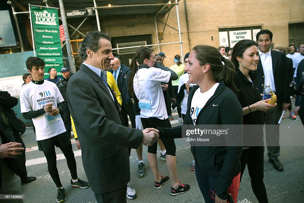 New York Governor Andrew Cuomo greets a runner at end of the first annual 9/11 Memorial 5K Run/Walk on April 21, 2013 in New York City. Security was tight for the race, as has been the case in large scale events around the country since the Boston Marathon bombings. April 21 marks the anniversary that President Barack Obama signed into law legislation making 9/11 a day of service and volunteerism in memory of the victims of the 2001 attacks.