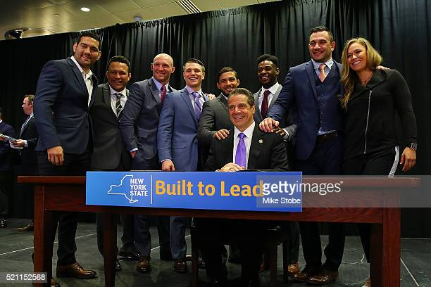 New York Governor Andrew Cuomo is joined by UFC fighters Chris Weidman Ryan LaFlare Chris Wade Dennis Bermudez Aljamain SterlingÊGian Villante and...