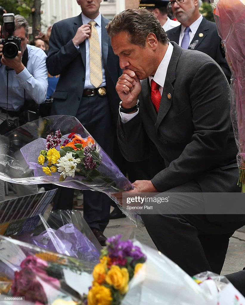 New York Governor Andrew Cuomo pauses in front of the iconic New York City gay and lesbian bar The Stonewall Inn to lay flowers and grieve for those killed in Orlando on June 13, 2016 in New York City. An American-born man who had recently pledged allegiance to ISIS killed 50 people early Sunday at a gay nightclub in Orlando, Florida. The massacre is the deadliest mass shooting in United States history.