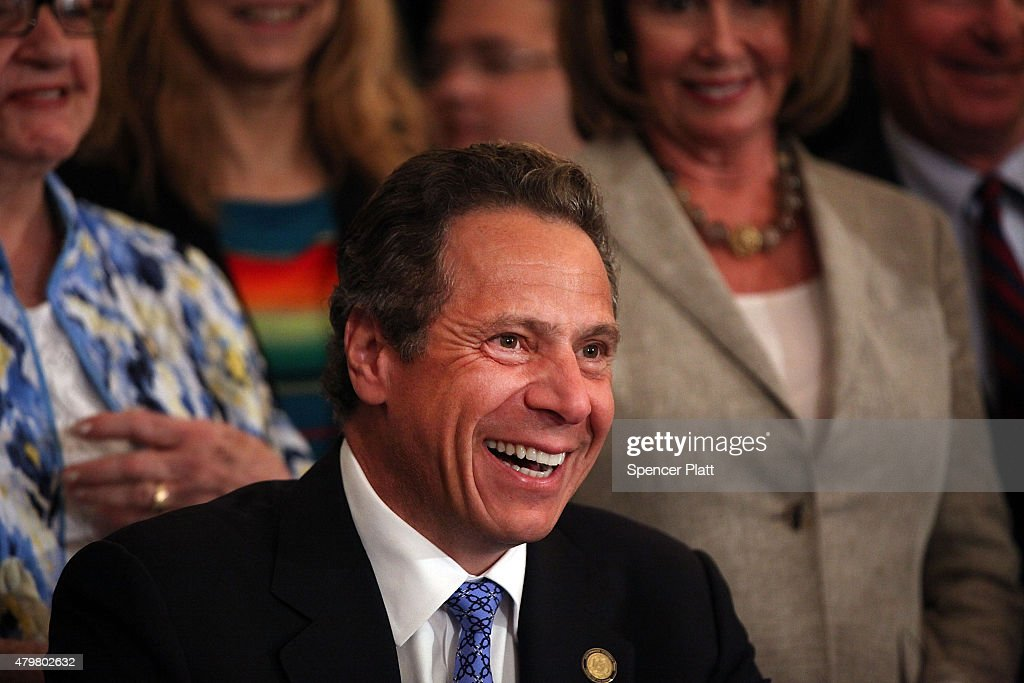 New York Governor <a gi-track='captionPersonalityLinkClicked' href=/galleries/search?phrase=Andrew+Cuomo&family=editorial&specificpeople=228332 ng-click='$event.stopPropagation()'>Andrew Cuomo</a> smiles as he signs into law a new affirmative sexual consent policy to combat campus sexual violence on July 7, 2015 in New York City. Joined by House Minority Leader Nancy Pelosi, local politicians and activists, the bill includes a 'yes means yes' definition of consent requiring a clear and affirmative agreement between sexual partners.