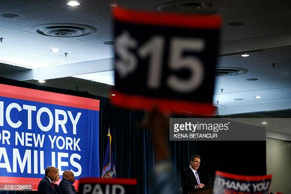 New York Governor Andrew Cuomo speaks during a event named as a 'victory rally for $15 minimum wage and paid family leave' at the Javitz Center in...
