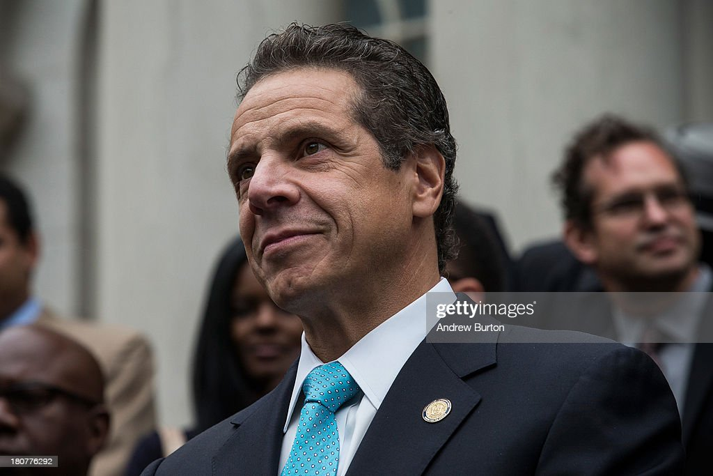 New York Governor <a gi-track='captionPersonalityLinkClicked' href=/galleries/search?phrase=Andrew+Cuomo&family=editorial&specificpeople=228332 ng-click='$event.stopPropagation()'>Andrew Cuomo</a> speaks outside New York City Hall after New York City mayoral hopeful Bill Thompson conceded defeat to New York City Democratic mayoral candidate Bill De Blasio, on September 16, 2013 in New York City. Thompson and De Blasio both hoped to win the democratic cadidate position for New York City. While De Blasio had a majority lead in the primary vote with approximately 40% of the votes, Thompson had hoped that he could force a run off between the two.