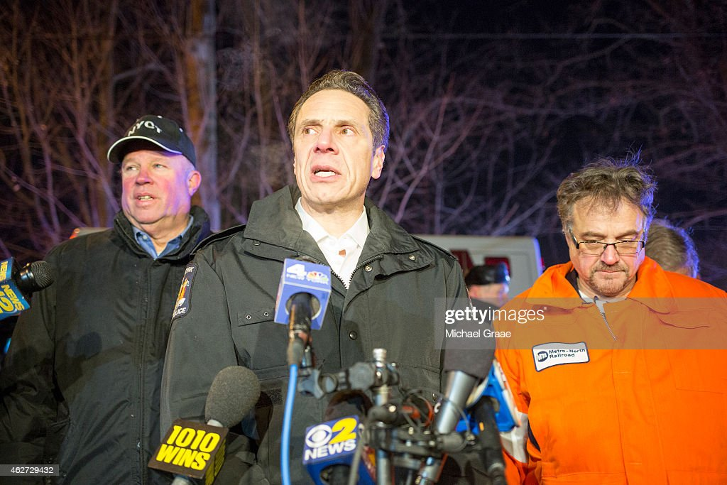 New York Governor Andrew Cuomo speaks to the media at the site of a MetroNorth commuter train crash on February 3 2015 in Valhalla New York A...