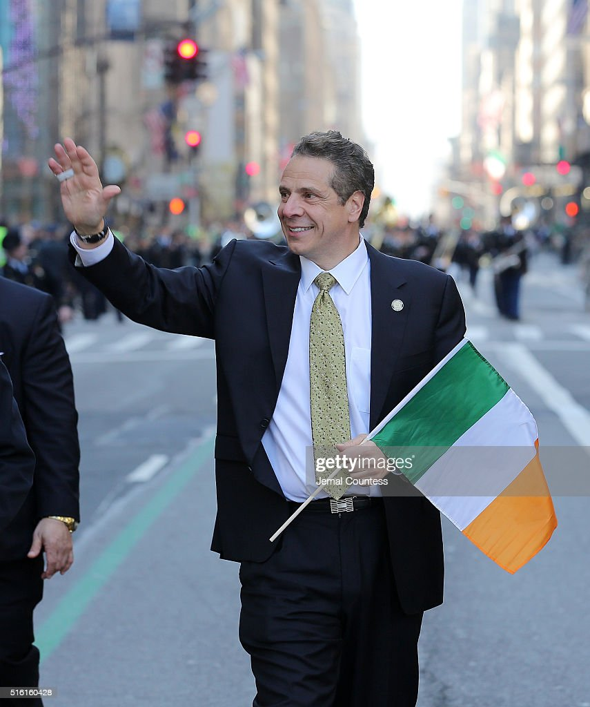 New York Governor Andrew Cuomo walks in the 255th annual St Patricks Day Parade along Fifth Avenue in New York City on March 17 2016 in New York City