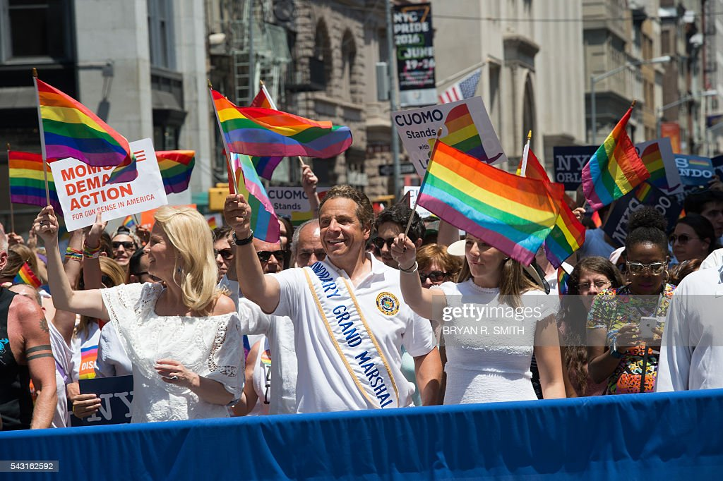 New York Governor Andrew Cuomo(C) walks with partner Sandra Lee(L) during the 46th annual Gay Pride march June 26, 2016 in New York. New York kicked off June 26 what organizers hope will be the city's largest ever Gay Pride march, honoring the 49 people killed in the Orlando nightclub massacre and celebrate tolerance. / AFP / the 46th / Bryan R. Smith