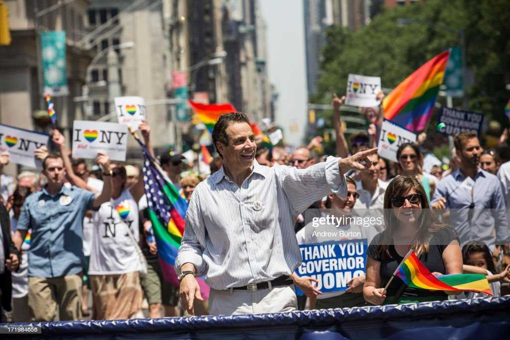 New York Governor Andrew Cuomo waves to revelers while marching in the New York Gay Pride Parade on June 30, 2013 in New York City. This year's parade was a particularly festive occasion, due to the recent Supreme Court Ruling that it was unconstitutional to ban gay marriage.