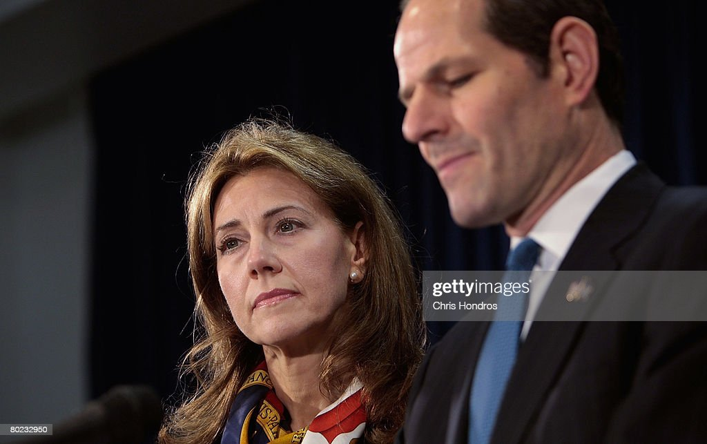 New York Governor Eliot Spitzer announces his resignation as his wife Silda Wall Spitzer stands next to him March 12 2008 in New York City New York...