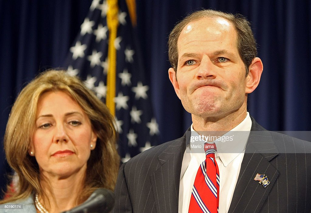 New York Governor Eliot Spitzer speaks to the media with his wife Silda Wall Spitzer while delivering an apology to his family and the public...
