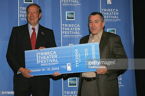 New York Governor George Pataki and actor Robert De Niro hold a giant ticket at the press conference to announce the First Annual Tribeca Theater...