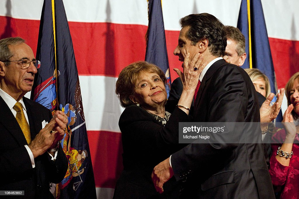New York Governorelect Andrew Cuomo celebrates with his father former New York Governor Mario Cuomo and mother Matilda Cuomo at the Sheraton New York...