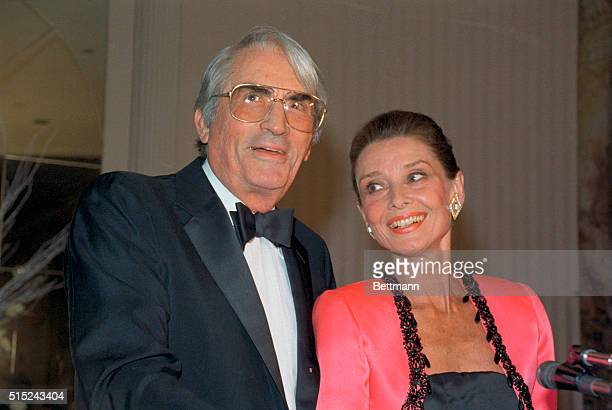 Gregory Peck shares a happy moment with Audrey Hepburn after he presented her with the first annual Winternight Award on behalf of the Lighthouse...