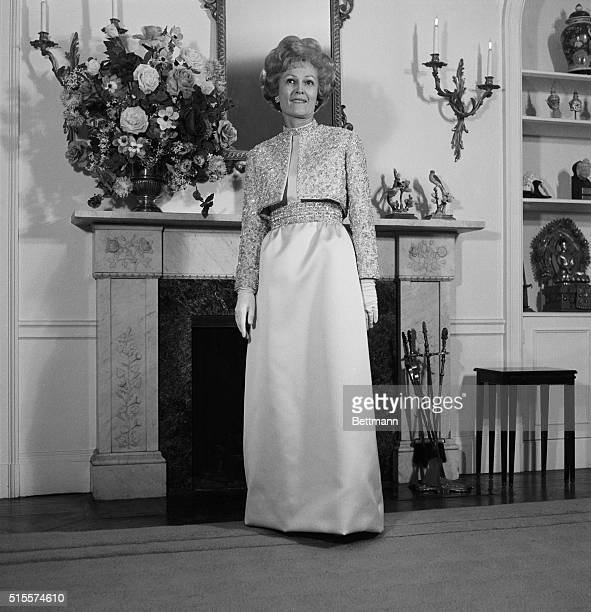 In her apartment here Mrs Pat Nixon models the Harvey Berin gown she will wear to the Inaugural Ball in Washington Jan 20th The mimosa yellow gown is...