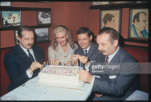 In Sardi's restaurant celebrating the 1000th performance of the Broadway hit Hello Dolly are left to right producer David Merrick star Ginger Rogers...