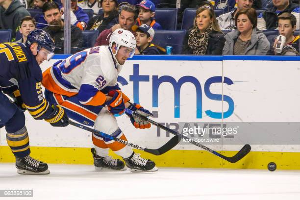 New York Islanders Center Brock Nelson skates with the puck as Buffalo Sabres Defenseman Rasmus Ristolainen defends during the New York Islanders and...
