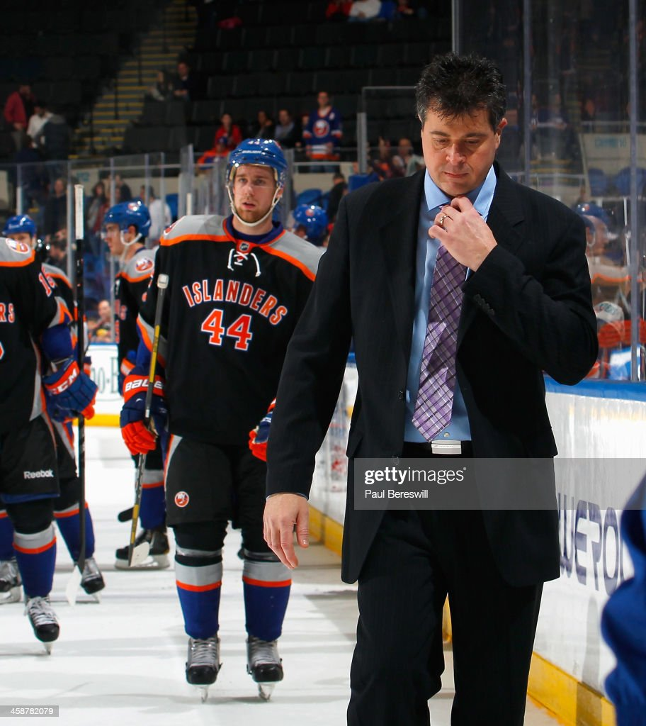 New York Islanders coach Jack Capuano walks off the ice after losing to the Anaheim Ducks at Nassau Veterans Memorial Coliseum on December 21 2013 in...
