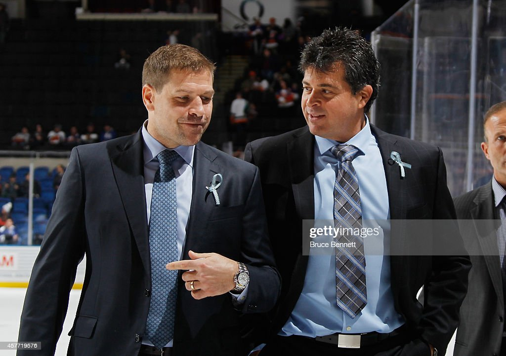 New York Islanders coaches Doug Weight and Jack Capuano leave the ice following the game agasint the Toronto Maple Leafs at the Nassau Veterans...