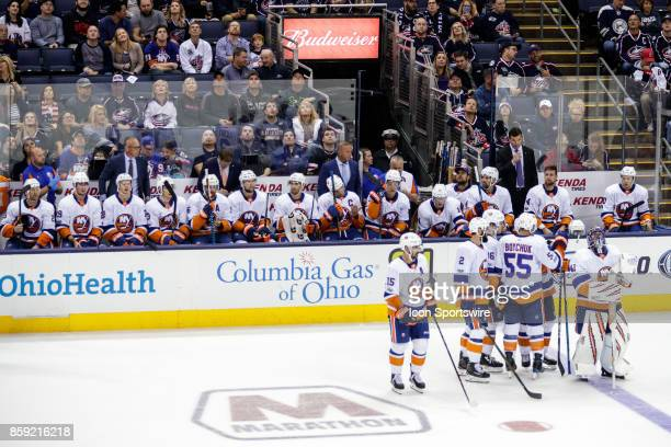 New York Islanders defenseman Johnny Boychuk and teammates stand on the ice in front of the players bench during a time out in the third period in a...