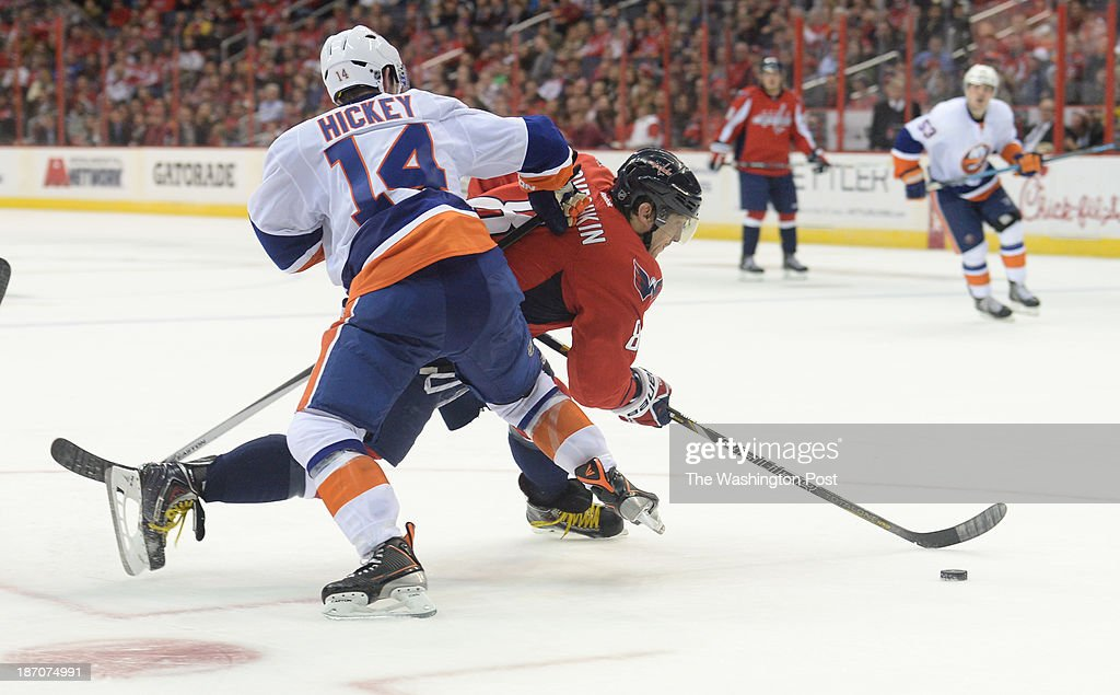 New York Islanders defenseman Thomas Hickey (14) is called for holding on Washington Capitals right wing Alex Ovechkin (8) as he goes to the goal during third period action on November 5, 2013 in Washington, DC.