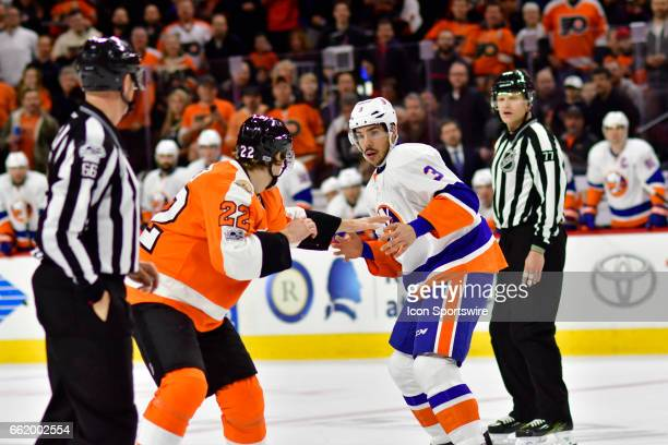 New York Islanders defenseman Travis Hamonic fights with Philadelphia Flyers right wing Dale Weise during the hockey game between the New York...