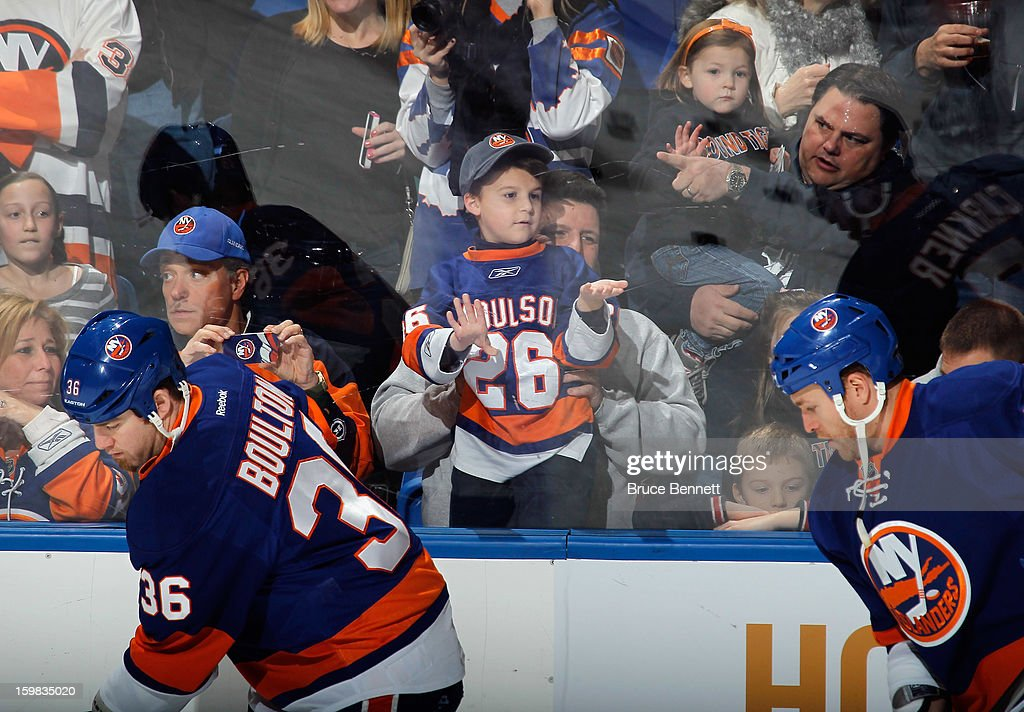 New York Islanders fans watch warmups prior to the game against the Tampa Bay Lightning at the Nassau Veterans Memorial Coliseum on January 21, 2013 in Uniondale, New York.