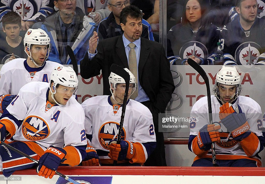 New York Islanders' head coach Jack Capuano gestures from the bench during third period action in a game against the Winnipeg Jets on April 20, 2013 at the MTS Centre in Winnipeg, Manitoba, Canada.