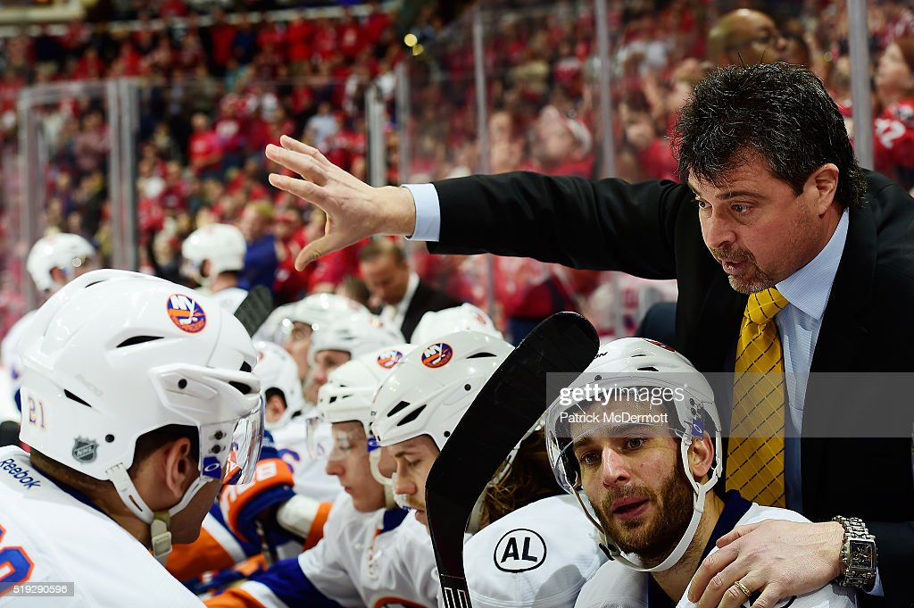 New York Islanders head coach Jack Capuano talks to his players on the bench in the third period during their game against the Washington Capitals at...