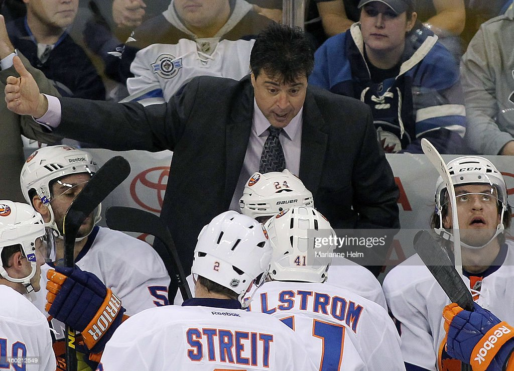 New York Islanders' head coach Jack Capuano talks to his team from the bench during a break in play in a game against the Winnipeg Jets in NHL action on January 27, 2013 at the MTS Centre in Winnipeg, Manitoba, Canada.