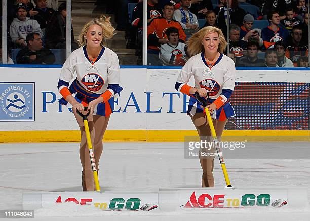 New York Islanders ice girls clear the ice during a break in the first period of an NHL hockey game against the Atlanta Thrashers at the Nassau...