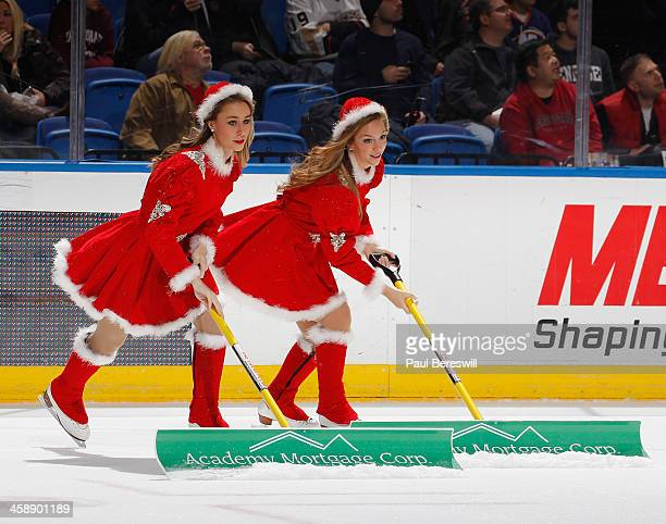 New York Islanders ice girls dressed in Santa outfits clean the ice during a break in action in an NHL hockey game between the Anaheim Ducks and the...