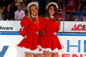 New York Islanders ice girls pose for a photo at Nassau Veterans Memorial Coliseum on December 14 2013 in Uniondale New York